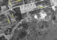 Fotografie z r. 1953. Po oprámech ani památky, krajina zbrázděna těžbou