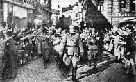 Německé vojsko vítáno, vstupuje do Mostu