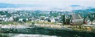 Pohled na postup porubní fronty lomu Most v sedmdesátých letech 20. století. Uhlí v okolí Mostu vedlo zpočátku k prosperitě města, ale uhelná sloj přímo pod Mostem se stala příčinou jeho zániku