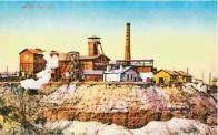 Doly na hnědé uhlí utvářely obraz zjizvené a znehodnocené krajiny Mostecka. Na dobovém záběru z roku 1927 důl Jan u Mostu