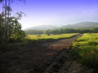 Vrcholy a kopce naší části Krušných hor.V popředí Koldům