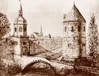 Špitálská brána, zvaná též Teplická, s částí hradeb. Své pojmenování získala podle blízkého špitálu s Komendou Křížovníků červené hvězdy. Zanikla v roce 1829