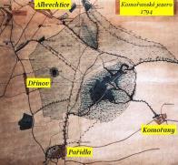 Komořanské jezero, které se vytvořilo přirozenou cestou na toku řeky Bíliny, ještě v 17. století označil Bohuslav Balbín za největší jezero v Českém království. V době největšího rozsahu plochy, tj. asi před 700 lety, mělo rozlohu až 56 km2. Nejdelší východozápadní osa měřila 13 km, severojižní 9,5 km, na nejhlubším místě mělo hloubku 40 m pod hladinou. Jezerní plocha se vlivem sedimentace splavenin z horských svahů stále zmenšovala.  V roce 1830 bylo jezero již z největší části mokřadlového typu. Ještě v roce 1832 sahaly bažiny až k Ervěnicím, Komořanům, Jezeří a Hornímu Jiřetínu. V průběhu 30. let 19. století bylo odvodněno a vysušeno, poté zmizelo i z map. Odvodněný prostor zaplnily ve 2. polovině 19. století ocelové konstrukce těžních věží a poté povrchových dolů, stal se územím nejvíce namáhaným těžební činností s krajinnou devastací.