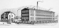 Tovární budova postavena roku 1907-1908 pokračovateli výroby plechových hraček - firmou Heller & Schiller na vrchnostenském poli jižně od města v nádražní ulici