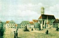 Třetí náměstí s kostelem piaristů v době 19. století. Na dávné pohlednici je uvedeno jako Gymnazijní náměstí ze starého Mostu