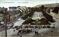 Kreslený pohled od východu na náměstí Císaře Josefa kolem r. 1914